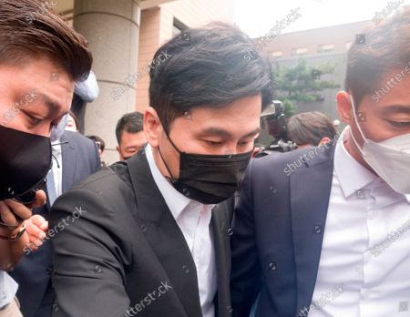 Stock Image of Yang Hyun-Suk, Sep 9, 2020 : Yang Hyun-Suk (C), the founder and former CEO of YG Entertainment, leaves after his trial at the Seoul Western District Court in Seoul, South Korea. Local media reported Yang admitted to charges that he gambled in casinos in Las Vegas in the U.S. over the past several years, during his first court hearing on the case. Yang and three others, including two co-CEOs of YG's affiliated music label YGX, are facing charges that they had gambled at Las Vegas casinos on some 20 occasions between 2015 and 2019 with combined gambling money of some 400 million won (US$336,785) at stake, according to local media. Yang stepped down as the CEO and the chief producer of YG Entertainment in June 2019.