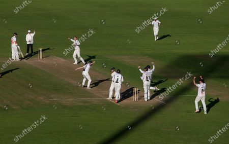 Tom Cullen of Glamorgan is bowled for LBW by Alex Thomson of Warwickshire.