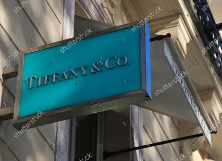The logo of Tiffany & Co. is pictured on the Champs Elysees avenue in Paris. Luxury goods giant LVMH is ending its takeover deal of the luxury jewelry retailer, citing in part the threat of proposed U.S. tariffs on French goods