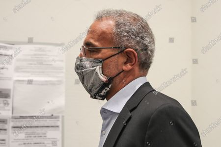 Tariq Ramadan, a Swiss Muslim writer, walks toward the court during his trial in Paris, France, 09 September 2020. Tariq Ramadan is sued for revealing the name of one of the women accusing him of rape 'known in media reports as Christelle', in a book published in 2019, and during an interview. The prosecution accuses him of having violated an article of law prohibiting the dissemination of information concerning the identity of a victim of sexual assault without her written consent. Ramadan, the grandson of the founder of Egypt's Muslim Brotherhood, was charged in France with raping a feminist activist in 2012 and a disabled woman in 2009. Ramadan denies the charges and insists all his relationships have been consensual.
