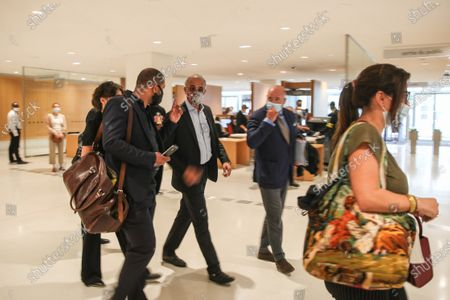 Tariq Ramadan (C), a Swiss Muslim writer, walks next to his lawyer toward the court during his trial in Paris, France, 09 September 2020. Tariq Ramadan is sued for revealing the name of one of the women accusing him of rape 'known in media reports as Christelle', in a book published in 2019, and during an interview. The prosecution accuses him of having violated an article of law prohibiting the dissemination of information concerning the identity of a victim of sexual assault without her written consent. Ramadan, the grandson of the founder of Egypt's Muslim Brotherhood, was charged in France with raping a feminist activist in 2012 and a disabled woman in 2009. Ramadan denies the charges and insists all his relationships have been consensual.