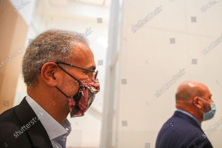 Tariq Ramadan (L), a Swiss Muslim writer, walks toward the court during his trial in Paris, France, 09 September 2020. Tariq Ramadan is sued for revealing the name of one of the women accusing him of rape 'known in media reports as Christelle', in a book published in 2019, and during an interview. The prosecution accuses him of having violated an article of law prohibiting the dissemination of information concerning the identity of a victim of sexual assault without her written consent. Ramadan, the grandson of the founder of Egypt's Muslim Brotherhood, was charged in France with raping a feminist activist in 2012 and a disabled woman in 2009. Ramadan denies the charges and insists all his relationships have been consensual.