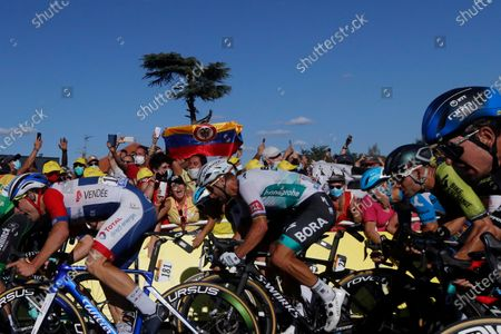Italy's Niccolo Bonifazio, left, and Slovakia's Peter Sagan, center, sprint to the finish line during the eleventh stage of the Tour de France cycling race over 167 kilometers (104 miles), with start in Chatelaillon-Plage and finish in Poitiers