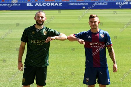 Uruguayan player Gaston Silva (L) and Spanish defender Pablo Maffeo pose during their presentation as new players of Spanish La Liga soccer club SD Huesca at  El Alcoraz stadium in Huesca, Spain, 09 September 2020.