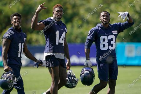 Stock Image of Seattle Seahawks wide receivers Phillip Dorsett II (11), DK Metcalf (14), and David Moore (83), react to seeing a camera as they leave the field on the last day of NFL football training camp for the team, in Renton, Wash. Metcalf didn't disappoint in his rookie season even after sliding in the draft. It's raised the expectations for what many are expecting to be a breakout season for Seattle's second-year wide receiver