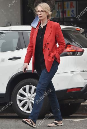 Stock Image of Jane Lynch runs errands in a red blazer