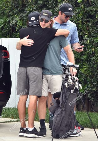 Stock Picture of Luke Benward goes golfing with friends