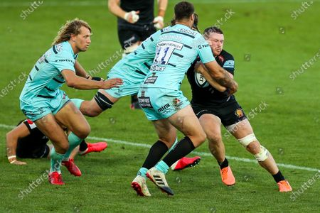 Sam Simmonds of Exeter Chiefs is tackled by Matt Banahan of Gloucester Rugby