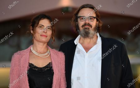 Giuseppe Battiston and guest arrive for the premiere of 'Le sorelle Macaluso' during the 77th annual Venice International Film Festival, in Venice, Italy, 09 September 2020. The movie is presented in the Official Competition 'Venezia77' at the festival running from 02 September to 12 September.The event is the first major in-person film fest to be held in the wake of the Covid-19 coronavirus pandemic. Attendees have to follow strict safety measures like mandatory face masks indoors, temperature scanners, and socially distanced screenings to reduce the risk of infection. The public is barred from the red carpet, and big stars are expected to be largely absent this year.
