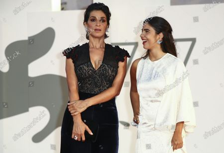 Actresses Donatella Finocchiaro, left, and Anita Pomario poses for photographers upon arrival at the premiere of the film Le Sorelle Macaluso (The Macaluso Sisters)' during the 77th edition of the Venice Film Festival in Venice, Italy