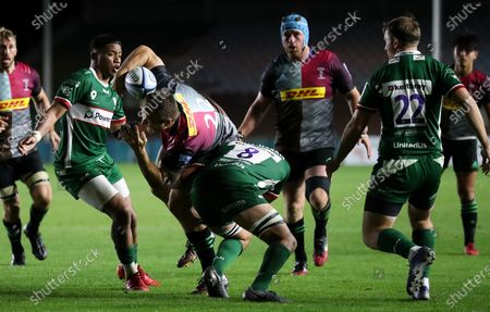 Andre Esterhuizen of Harlequins is tackled buy Isaac Curtis-Harris of London Irish