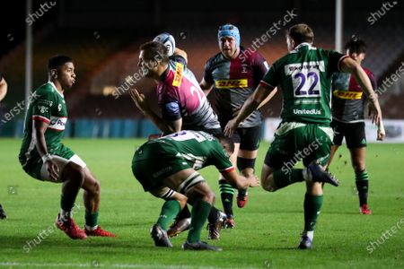 Stock Photo of Andre Esterhuizen of Harlequins is tackled buy Isaac Curtis-Harris of London Irish