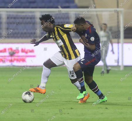 Al-Adalah player Bader Al Nakhli (R) in action against Al-Ittihad player Wilfried Bony (L) during the Saudi Professional League soccer match between Al-Adalah and Al-Ittihad, in Al-Hasa, Saudi Arabia, 09 September 2020.