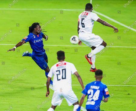 Al-Hilal's player Bafetimbi Gomis (L) in action against Al-Shabab's Abdulmalek Al-Khaibri (R) during the Saudi Professional League soccer match between Al-Hilal and Al-Shabab, in Riyadh, Saudi Arabia, 09 September 2020.