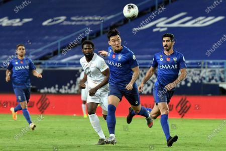 Al-Hilal's player Hyun Soo Jang (C) in action against Al-Shabab's Makhete Diop (2-L) during the Saudi Professional League soccer match between Al-Hilal and Al-Shabab, in Riyadh, Saudi Arabia, 09 September 2020.