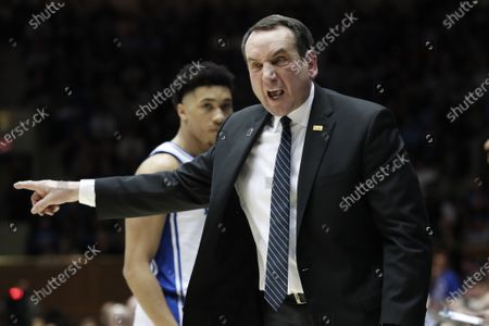 """Duke head coach Mike Krzyzewski reacts to an official during the second half of an NCAA college basketball game against North Carolina in Durham, N.C. Atlantic Coast Conference men's basketball coaches are pushing the idea of having next year's NCAA Tournament include all eligible teams in Division I. """"This is not a regular season,"""" Duke coach Mike Krzyzewski said in a statement"""