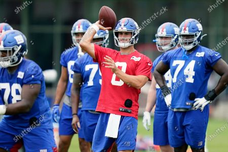 New York Giants quarterback Daniel Jones, center, participates in a practice at the NFL football team's training camp in East Rutherford, N.J. Daniel Jones is heading into his second season with the New York Giants in a different position. The skinny kid from Duke is no longer the heir apparent at quarterback to two-time Super Bowl MVP Eli Manning, who retired after last season