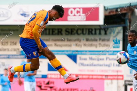 Stock Photo of Jamie Reid of Mansfield Town shoots at goal
