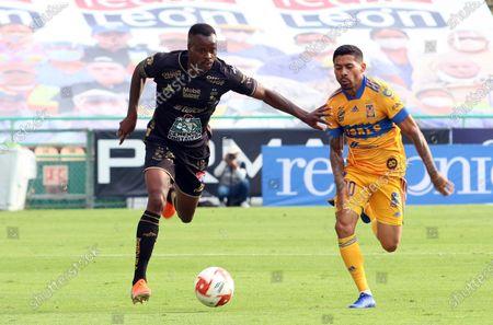 Jaine Barreiro (L) of Leon in action against Javier Aquino (R) of Tigres UANL during the 2020 Liga MX Apertura Tournament soccer match between Leon and Tigres UANL at the Leon Stadium, in Leon, Mexico, 09 September 2020.