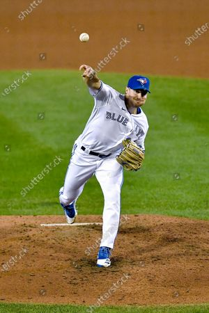 Toronto Blue Jays pitcher Ross Stripling throws to a New York Yankees batter during the fifth inning of a baseball game in Buffalo, N.Y