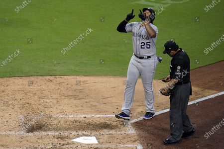 Colorado Rockies' Matt Kemp reacts after hitting a two-run home run during the sixth inning of the team's baseball game against the San Diego Padres, in San Diego