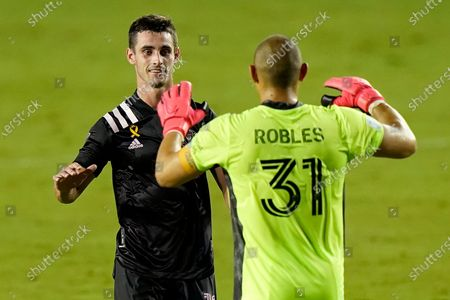 Inter Miami defender Dylan Nealis, left, celebrates with goalkeeper Luis Robles (31) after an MLS soccer match against Atlanta United, in Fort Lauderdale, Fla. Inter Miami won 2-1