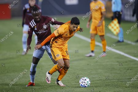 Stock Image of Houston Dynamo defender Jose Bizama, front, works for the ball in front of Colorado Rapids forward Kei Kamara during the first half of an MLS soccer match, in Commerce City, Colo