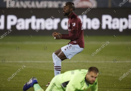 Stock Picture of Colorado Rapids forward Kei Kamara, back, reacts after missing a shot as Houston Dynamo goalkeeper Marko Maric dives for the ball during the first half of an MLS soccer match, in Commerce City, Colo