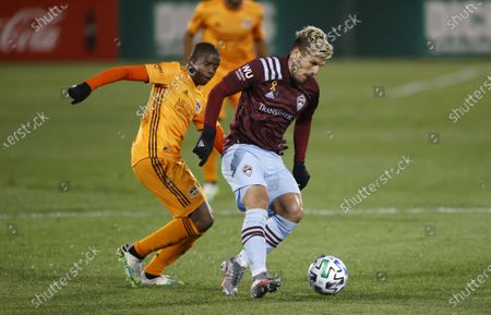 Colorado Rapids forward Diego Rubio, right, takes control of the ball as Houston Dynamo midfielder Oscar Garcia pursues during the second half of an MLS soccer match, in Commerce City, Colo. The match ended in a 1-1 draw