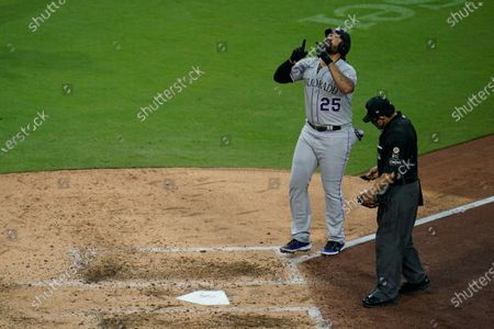 Colorado Rockies' Matt Kemp reacts after hitting a two-run home run during the sixth inning of a baseball game against the San Diego Padres, in San Diego