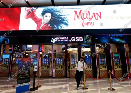 Thai moviegoers buy tickets next to an advertisement of Mulan movies at a cinema in Bangkok, Thailand, 10 September 2020. Thai pro-democracy activists join the global calling to boycott Disney's Mulan movie after it was found out that the leading actress Liu Yifei shared a post on social media supporting China's crackdown policy against Hong Kong protesters. According to the SEMrush data-trends company, the Google searches for 'Boycott Mulan' increased 1,900 per cent from the movie release date on 04 September 2020.