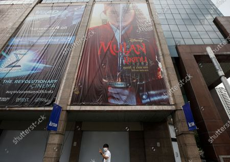 A Thai man walks under an advertising poster of Mulan movie at a shopping mall in Bangkok, Thailand, 10 September 2020. Thai pro-democracy activists join the global calling to boycott Disney's Mulan movie after it was found out that the leading actress Liu Yifei shared a post on social media supporting China's crackdown policy against Hong Kong protesters. According to the SEMrush data-trends company, the Google searches for 'Boycott Mulan' increased 1,900 per cent from the movie release date on 04 September 2020.