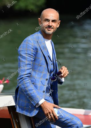 Enzo Miccio arrives at the Lido Beach for the 77th annual Venice International Film Festival, in Venice, Italy, 10 September 2020. The event is the first major in-person film fest to be held in the wake of the Covid-19 coronavirus pandemic. Attendees have to follow strict safety measures like mandatory face masks indoors, temperature scanners, and socially distanced screenings to reduce the risk of infection. The public is barred from the red carpet, and big stars are expected to be largely absent this year. The 77th edition of the festival runs from 02 to 12 September 2020.