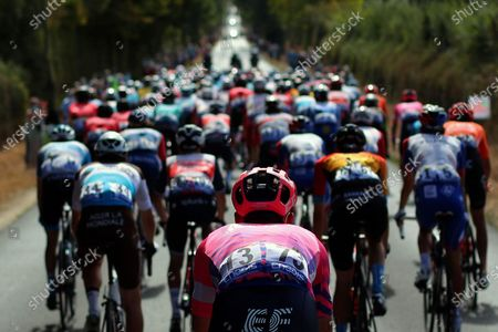 Britain's Hugh John Carthy rides in the pack during the stage 12 of the Tour de France cycling race over 218 kilometers from Chauvigny to Sarran