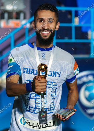 Al-Hilal's player Salman Al-Faraj pose for a photo and celebrate after winning the Prince Mohammed bin Salman League Cup for a historical 16 times after defeating Al-Shabab by a score of 2-1, in Riyadh, Saudi Arabia, 09 September 2020 (issued 10 September 2020).