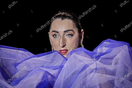 Spanish actress Rossy de Palma displays a creation of Spanish designer Andres Sarda during the Mercedes-Benz Fashion Week in Madrid, Spain