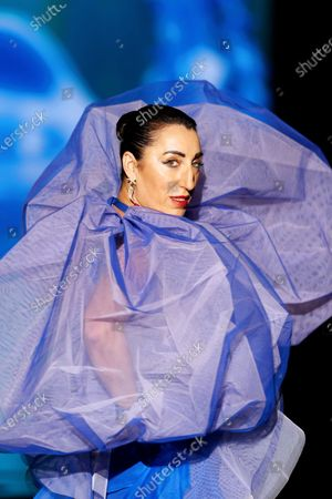 Spanish actress Rossy de Palma presents a creation by Spanish designer Andres Sarda during a cawalk show on the first day of the 72nd Mercedes-Benz Fashion Week in Madrid, Spain, 10 September 2020. The MBFWMadrid runs from 10 to 13 September 2020 under security measures due to the ongoing pandemic of the COVID-19 disease caused by the SARS-CoV-2 coronavirus.