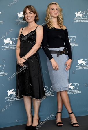 Radha Mitchell (L) and US actress Isabel May pose at a photocall for 'Run Hide Fight' during the 77th annual Venice International Film Festival, in Venice, Italy, 10 September 2020. The movie is presented out of Competition at the festival running from 02 September to 12 September. The event is the first major in-person film fest to be held in the wake of the Covid-19 coronavirus pandemic. Attendees have to follow strict safety measures like mandatory face masks indoors, temperature scanners, and socially distanced screenings to reduce the risk of infection. The public is barred from the red carpet, and big stars are expected to be largely absent this year. The 77th edition of the festival runs from 02 to 12 September 2020.