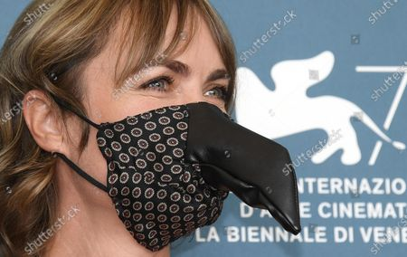 Radha Mitchell wearing a protective mask poses at a photocall for 'Run Hide Fight' during the 77th annual Venice International Film Festival, in Venice, Italy, 10 September 2020. The movie is presented out of Competition at the festival running from 02 September to 12 September. The event is the first major in-person film fest to be held in the wake of the Covid-19 coronavirus pandemic. Attendees have to follow strict safety measures like mandatory face masks indoors, temperature scanners, and socially distanced screenings to reduce the risk of infection. The public is barred from the red carpet, and big stars are expected to be largely absent this year. The 77th edition of the festival runs from 02 to 12 September 2020.
