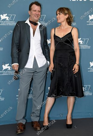 Thomas Jane (L) and Australian actress Radha Mitchell pose at a photocall for 'Run Hide Fight' during the 77th annual Venice International Film Festival, in Venice, Italy, 10 September 2020. The movie is presented out of Competition at the festival running from 02 September to 12 September. The event is the first major in-person film fest to be held in the wake of the Covid-19 coronavirus pandemic. Attendees have to follow strict safety measures like mandatory face masks indoors, temperature scanners, and socially distanced screenings to reduce the risk of infection. The public is barred from the red carpet, and big stars are expected to be largely absent this year. The 77th edition of the festival runs from 02 to 12 September 2020.