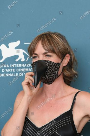 Radha Mitchell with protective mask in the shape of carnival mask
