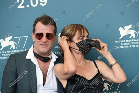 Stock Photo of Thomas Jane, Radha Mitchell with protective mask in the shape of carnival mask