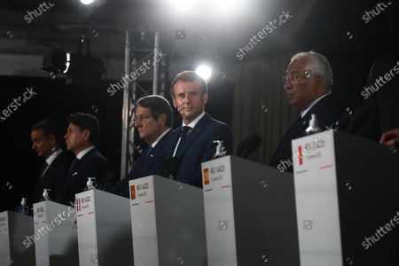 French President Emmanuel Macron (C) looks on during the closing press conference of the seventh MED7 Mediterranean countries summit with (from L) Greek Prime Minister Kyriakos Mitsotakis, Italy's Prime Minister Giuseppe Conte, Cyprus President Nikos Anastasiadis and Portugal's Prime Minister Antonio Costa in Porticcio, Corsica, France, 10 September 2020. French president is on a two day official trip to Corsica to attend the 7th MED7 Mediterranean countries summit held in Porticcio, near Ajaccio, on 10 September 2020.