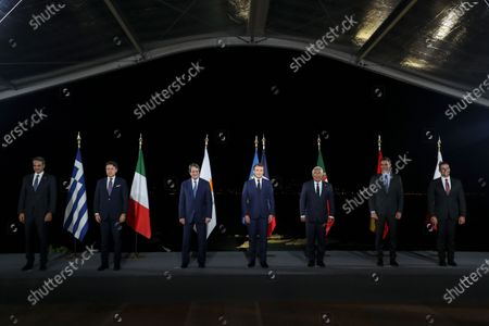 (From L) Greek Prime Minister Kyriakos Mitsotakis, Italy's Prime Minister Giuseppe Conte, Cyprus President Nikos Anastasiadis, French President Emmanuel Macron, Portugal's Prime Minister Antonio Costa, Spain's Prime Minister Pedro Sanchez, and Malta's Prime Minister Robert Abela pose after the closing press conference of the seventh MED7 Mediterranean countries summit in Porticcio, Corsica, France, 10 September 2020.