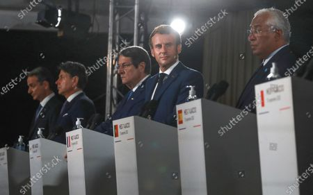 From left to right, Greek Prime Minister Kyriakos Mitsotakis, Italy's Prime Minister Giuseppe Conte, Cyprus President Nikos Anastasiadis, France's President Emmanuel Macron and Portugal's Prime Minister Antonio Costa attend a media conference after an emergency summit in Porticcio, Corsica island, Thursday Sept.10, 2020. Leaders of EU countries on the Mediterranean Sea are holding an emergency summit in Corsica on Thursday amid fears of open conflict with Turkey stemming from mounting tensions over oil and gas drilling