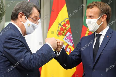 Cyprus President Nikos Anastasiadis, left, is welcomed by French President Emmanuel Macron to an emergency summit in Porticcio, Corsica island, Thursday Sept.10, 2020. Leaders of EU countries on the Mediterranean Sea are holding an emergency summit in Corsica on Thursday amid fears of open conflict with Turkey stemming from mounting tensions over oil and gas drilling