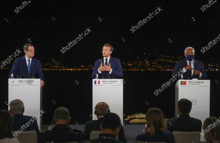 From left to right, Cyprus President Nikos Anastasiadis, France's President Emmanuel Macron and Portugal's Prime Minister Antonio Costa attend a media conference after an emergency summit in Porticcio, Corsica island, Thursday Sept.10, 2020. Leaders of EU countries on the Mediterranean Sea are holding an emergency summit in Corsica on Thursday amid fears of open conflict with Turkey stemming from mounting tensions over oil and gas drilling