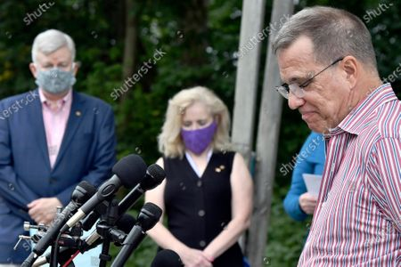 Stock Picture of Joe Desiato, father of U.S. Marine Lance Cpl. Travis Desiato who was killed in 2004, speaks to reporters as, from left Brian Hart, father of U.S. Army Pfc. John Hart who was killed in 2003, and Laurie Desiato look on during a news conference, in Bedford, Mass. The two families of servicemen from Bedford, Mass., addressed reports of President Trump's remarks about military service by the bridge named as a memorial to their sons