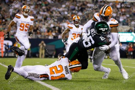 Cleveland Browns' Denzel Ward (21) and then-Browns player Christian Kirksey (58), right, tackle New York Jets' Le'Veon Bell (26) during the second half of an NFL football game, in East Rutherford, N.J. Green Bay Packers linebacker Christian Kirksey was one of the NFL's most prolific tacklers before injuries caused him to miss most of the last two seasons. Now the former the Cleveland Brown is with a new team and eager to boost a run defense that was gashed in last years NFC championship game