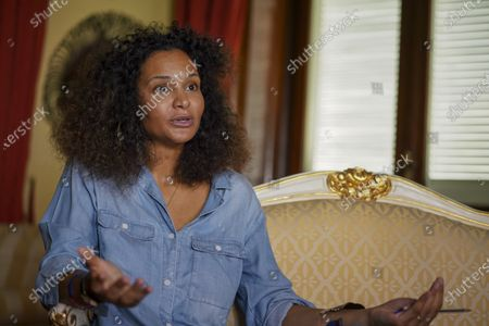Fashion designer Stella Jean talks during an interview with the Associated Press, in Rome. The Italian fashion council's only Black designer has hailed as a ''breakthrough'' the inclusion of a Black Lives Matters event to the official September show calendar and the formation of a working group aimed at ending racial discrimination in Italian fashion. Stella Jean, a Haitian-Italian designer based in Rome, has been pressuring the Italian National Fashion Chamber to promote cultural reform through concrete commitments toward greater racial diversity, spurred by top fashion house's social media posts supporting Black Lives Matters